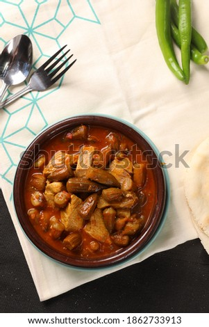Okra with tomato sauce and meat