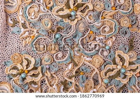 Crochet knitting. Lace of flowers.  Handmade Irish lace as a background Royalty-Free Stock Photo #1862770969