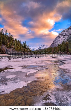 Sunrise clouds over an icy river Royalty-Free Stock Photo #1862784661