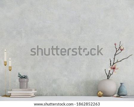 Modern room decoration. Flower pots, candle holder and books on white table with white wall background.