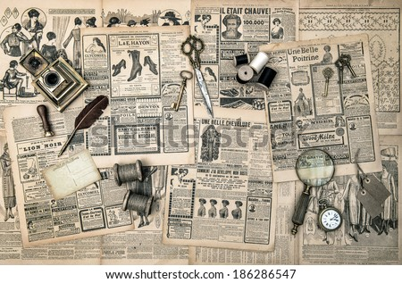 antique accessories, sewing and writing tools, vintage fashion magazine for the woman. collectibles. retro style toned picture