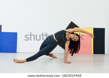 Beautiful brunette woman engaged in yoga asana gymnastics fitness flexibility body