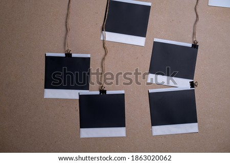 Blank photo frame set hanging on a clip. Retro vintage style. Vertical and horizontal photo design template. Black empty place for your text or photo