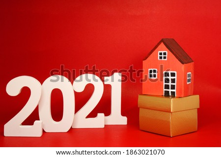 Home Property 2021 , 2021 number wood with House model on red pattern background - home new year - red concept of Real Estate, Property for Sale and rent #1863021070