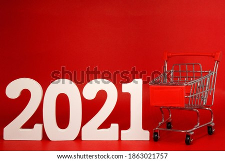 2021 Shopping Cart on Red background - new year 2021 - Business Shopping stores to buy goods concept - Black Friday Deal   #1863021757