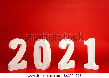 New year 2021 , 2021 number wood object on red background and copy space - red new year celebrate concept  #1863024793