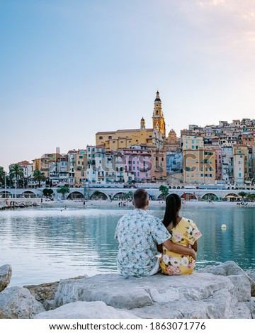 Menton France,couple men and woman on vacation at the Cote d Azur France, View on old part of Menton, Provence-Alpes-Cote d'Azur, France Europe Royalty-Free Stock Photo #1863071776