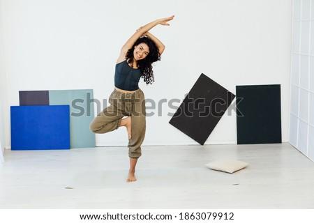 Beautiful brunette woman engaged in yoga asana gymnastics fitness flexibility body sport