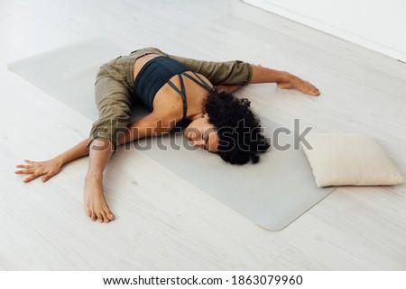 Brunette woman engaged in yoga asana gymnastics fitness flexibility body sport