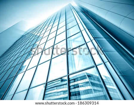 Panoramic and prospective wide angle view to steel light blue background of glass high rise building skyscraper commercial modern city of future. Business concept of successful industrial architecture #186309314