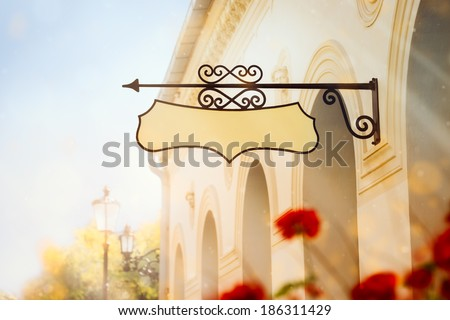 Building with a Wrought Iron Sign - Vintage building with a wrought iron sign
