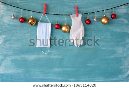 christmas in times of corona virus lockdown,christmas balls, surgical gloves,face mask,symbol picture, free copy space