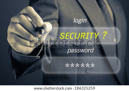 Businessman with Internet Security concept, log in and password button on screen #186325259