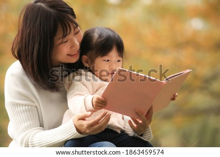Image of parents and children reading