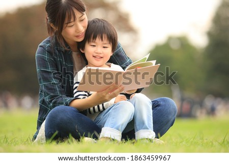 Parents and children reading books