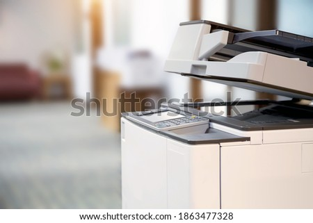 Close-up the copier or Xerox printer machine is office work tool in copy room for scanning document printout a paper and photocopy. Royalty-Free Stock Photo #1863477328