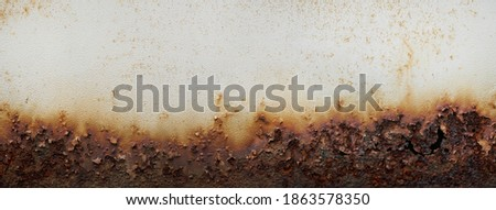 Rust of metals.Corrosive Rust on old iron white.Use as illustration for presentation.corrosion.Background rust texture as a panorama.  Royalty-Free Stock Photo #1863578350