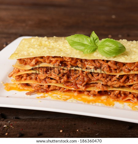 Tasty lasagne with meat, cheese and sauce