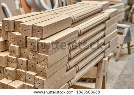 Turning wooden stair balusters. Wood stair balusters stacked after sanding in workshop Royalty-Free Stock Photo #1863608668