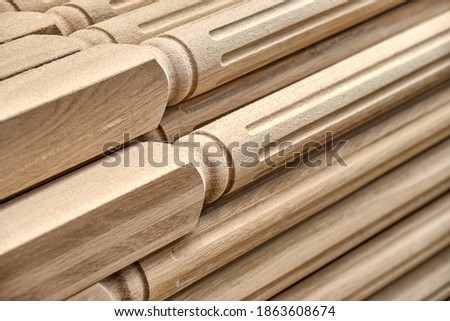 Turning wooden stair balusters. Wood stair balusters stacked after sanding in workshop Royalty-Free Stock Photo #1863608674