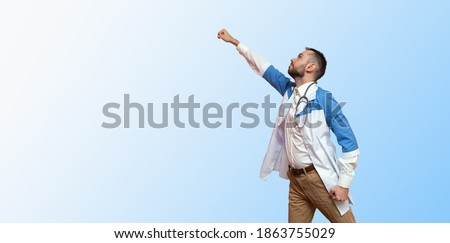 doctor superhero flying like a superman and fighting disease isolated on blue background.