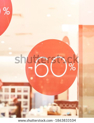 Sale percent sign. Store background. Black Friday concept. Business shop label. Mall interior advertising. Retail banner. Special discount. Light background. Clothes boutique. Red price color