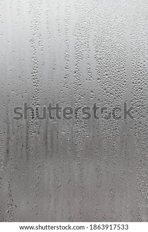 Dripping Condensation, Water Drops Background Rain drop Condensation Texture. Close up for misted glass with droplets of water draining down  Royalty-Free Stock Photo #1863917533