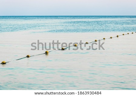 Limiting buoys on the sea background in the evening Royalty-Free Stock Photo #1863930484