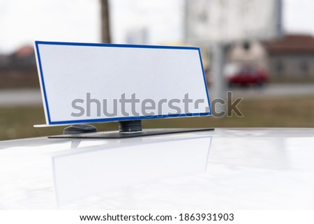 White Sign Magnetic on Roof a Car Copyspace