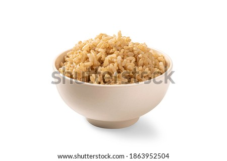 Brown rice in white cup isolated on white background. Royalty-Free Stock Photo #1863952504