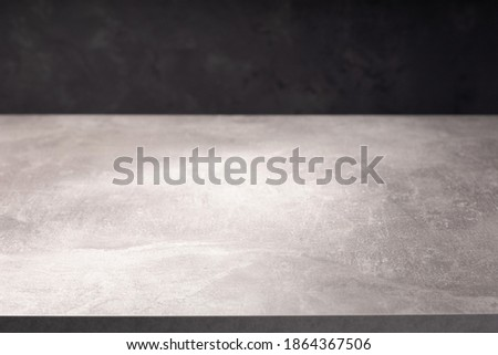wooden table or tabletop near wall background, front low angle view Royalty-Free Stock Photo #1864367506