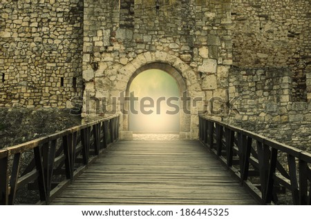 Door to Heaven. Light at end of the tunnel. Hope metaphor. #186445325
