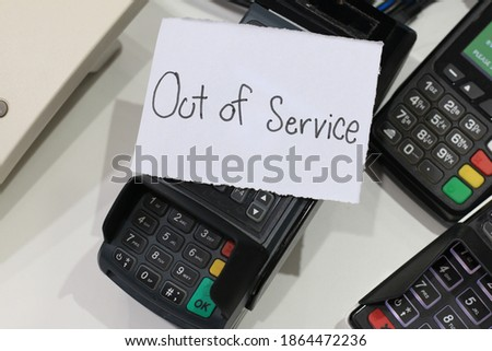 The sign in the picture show that this machine is out of service.