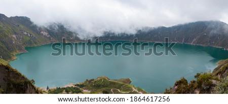 spectacular panoramic view of lake inside crater natural landscape, quilotoa in ecuador latin america