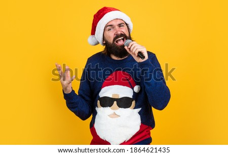 christmas music. bearded mature man wear knitted sweater sing in microphone. ready for celebration. prepare for winter holidays. party fun. happy new year. merry christmas. seasonal xmas sales.