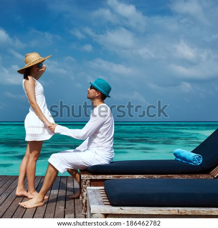 Couple on a tropical beach jetty at Maldives #186462782