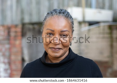 Portrait of a healthy and happy middle-aged African woman living with HIV Royalty-Free Stock Photo #1864631416