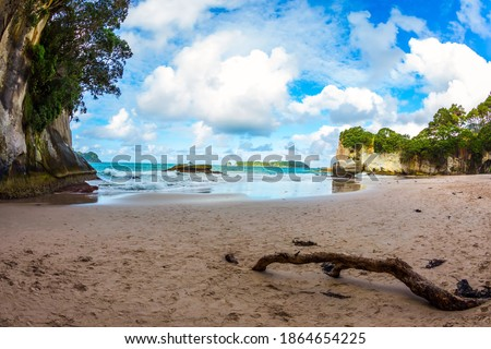 The North Island of New Zealand. Cathedral Cove on Coromandel Peninsula. The Pacific Ocean. The evening tide begins. The concept of exotic, ecological and photo tourism