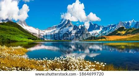 Sunrise view on Bernese range above Bachalpsee lake. Peaks Eiger, Jungfrau, Faulhorn in famous location in Switzerland alps, Grindelwald valley Royalty-Free Stock Photo #1864699720