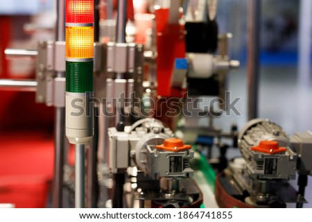 Industrial tower signal lights indicate the error status of the production line. Selective focus. Royalty-Free Stock Photo #1864741855