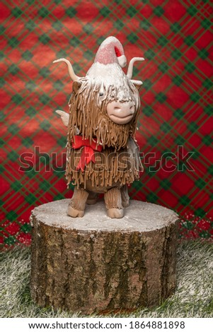 Christmas Highland cow sugar fondant model with snow icing sugar
