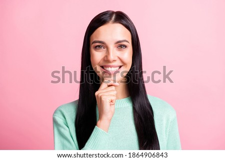 Photo portrait of smart smiling brunette thinking about new idea touching chin isolated on pastel pink color background