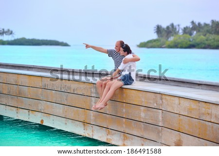 happy young romantic couple in love have fun running and relaxing on beautiful beach #186491588