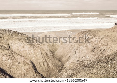 Ocean view natural background.Overlooking the beach in warm, luminous and serene tones from the coast. Return to the calm of nature.Land and sea water background.Move on, optimism,fall forward concept Royalty-Free Stock Photo #1865200549