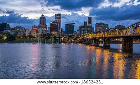 Portland skyline with colorful lights reflecting off the Willamette River at night