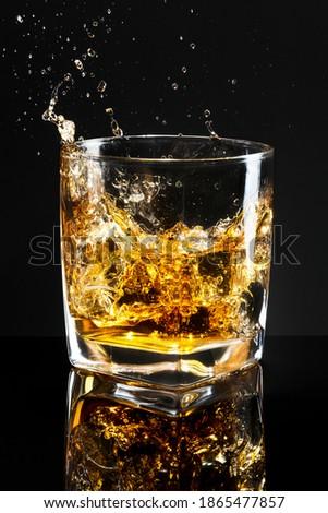 Whiskey on the rocks black background
