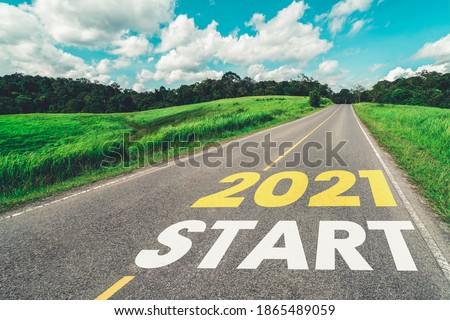 2021 New Year road trip travel and future vision concept . Nature landscape with highway road leading forward to happy new year celebration in the beginning of 2021 for fresh and successful start . Royalty-Free Stock Photo #1865489059