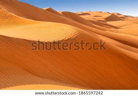 Sand dunes in the Wahiba desert  Royalty-Free Stock Photo #1865597242