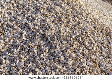 a pile of rubble stockpiled for use in road construction, selective focus Royalty-Free Stock Photo #1865606254