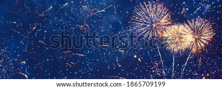 Beautiful Wide Angle celebration background of glitter lights and fireworks. Panoramic template for design Greeting card for Christmas holidays, New year, anniversary, independence day, Birthday